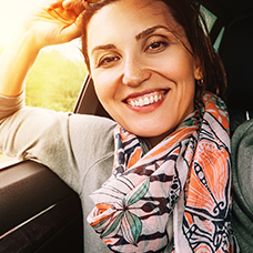 Girl smiling in a car.