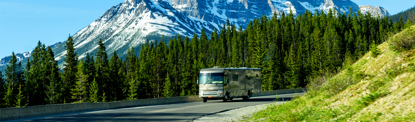 An RV driving down a mountain road.