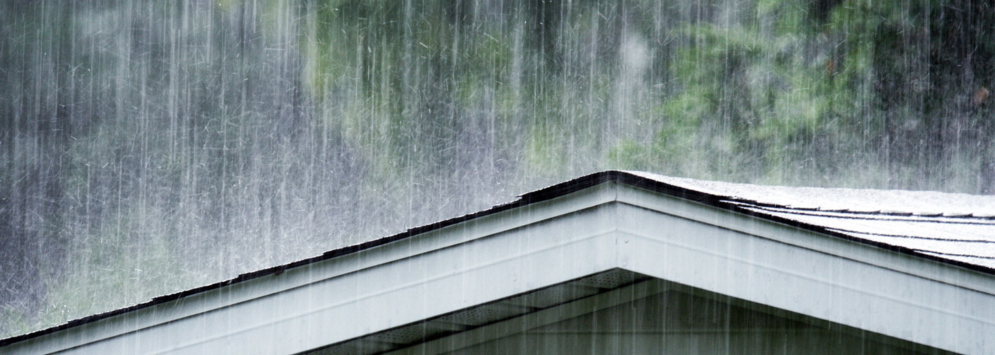 Rain pouring down on a roof